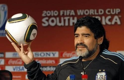 Argentina's coach Diego Maradona holds a ball before a news conference at the Loftus Versfeld Stadium in Pretoria