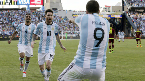 Argentina's Gabriel Mercado (4) and Lionel Messi (10) celebrate a goal by Gonzalo Higuain (9) during the first half of a Copa America Centenario quarterfinal soccer match against Venezuela on Saturday, June 18, 2016, in Foxborough, Mass. (AP Photo/Charles Krupa)
